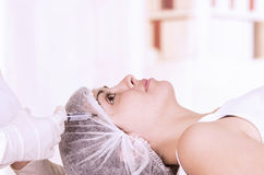 Young girl lying down ready to get a cosmetic Royalty Free Stock Image