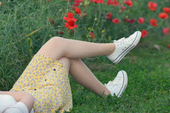 Young girl  lying on field Stock Photos