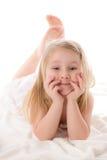 Young girl lying on floor in studio Stock Image