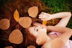 Young girl lying on grass Royalty Free Stock Photos