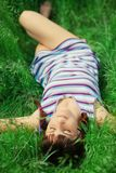 Young girl lying in grass Stock Images