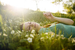 Young girl lying on the grass Royalty Free Stock Photos