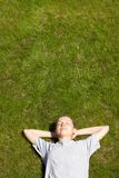 Young girl lying on the grass Royalty Free Stock Image
