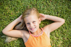 Young girl lying on grass Royalty Free Stock Images