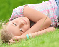 Young girl lying on the grass. Royalty Free Stock Images