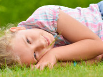 Young girl lying on the grass. Stock Photo