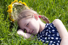 Young girl lying on green grass Royalty Free Stock Photography