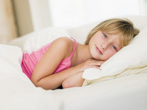 Young Girl Lying In Her Bed Stock Photo