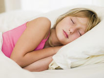Young Girl Lying In Her Bed Royalty Free Stock Photos