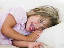 Young Girl Lying In Her Bed Stock Images