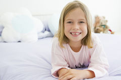 Young Girl Lying On Her Bed In Her Pajamas royalty free stock photography