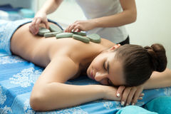 Young girl lying on her stomach having massage Royalty Free Stock Image