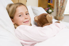 Young Girl Lying In Hospital Bed Royalty Free Stock Photos
