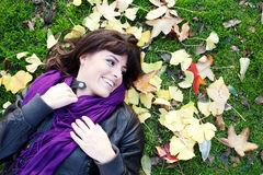 Young girl lying in leaves Royalty Free Stock Images