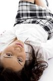 Young girl lying and looking at camera Stock Images