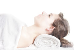 Young girl lying massage spa. Young beautiful girl lying on a massage table at spa Stock Photography