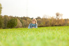 Young girl lying in park on green Royalty Free Stock Images