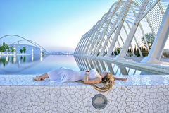 A young girl lying beside the pool Stock Photo