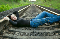 Young girl lying on the railway Stock Image