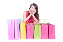 Young girl lying with shopping bags Royalty Free Stock Photos
