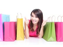 Young girl lying with shopping bags Stock Photos