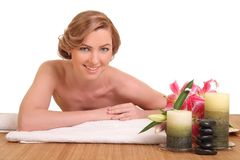 Young girl lying in a spa. Beautiful young girl lying in a spa royalty free stock images