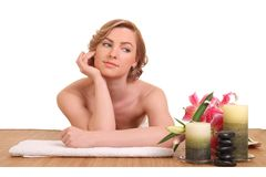Young girl lying in a spa. Beautiful young girl lying in a spa stock photos