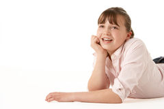 Young Girl Lying On Stomach Stock Photo