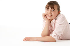 Young Girl Lying On Stomach In Studio Royalty Free Stock Image