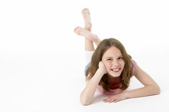 Young Girl Lying On Stomach In Studio Royalty Free Stock Images