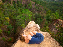 Young girl lying on top of the rock in the canyon Royalty Free Stock Photography