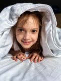 Young girl lying under the blanket Royalty Free Stock Photo