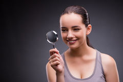 The young girl with magnifying glass Stock Photo