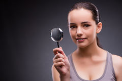 The young girl with magnifying glass Royalty Free Stock Photography