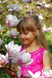 Young girl with magnolia Royalty Free Stock Image
