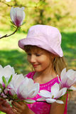 Young girl with magnolia Royalty Free Stock Photo