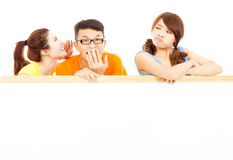 Young girl make a funny expression with friends. Over white Stock Photos