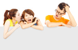 Young girl make a surprising expression with painful man Stock Images