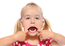 Young girl makes funny face Royalty Free Stock Photography