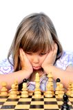 Young girl  makes her move in a game of ches Stock Photography