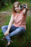 A young girl makes selfie Stock Photography