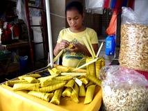 A young girl makes suman Stock Image