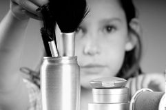 Young girl by makeup. Young girl getting into mommy's makeup supplies Stock Images