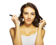 Young girl with makeup brush Royalty Free Stock Images