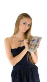 Young girl with makeup set Royalty Free Stock Photo