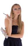 Young girl with makeup set Royalty Free Stock Photos