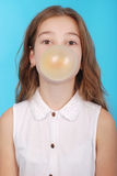 Young girl making a big bubble with a chewing gum Royalty Free Stock Photo