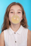 Young girl making a big bubble with a chewing gum Royalty Free Stock Photography