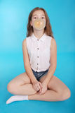 Young girl making a big bubble with a chewing gum Stock Images