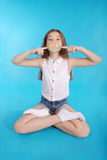 Young girl making a big bubble with a chewing gum Stock Photo